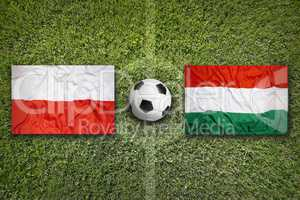 Poland vs. Hungary flags on soccer field
