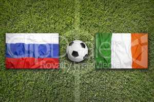 Russia vs. Ireland flags on soccer field