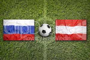Russia vs. Austria flags on soccer field