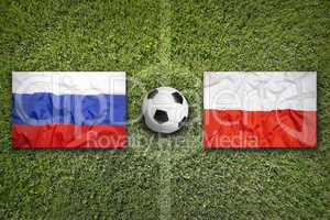 Russia vs. Poland flags on soccer field