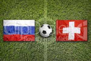 Russia vs. Switzerland flags on soccer field