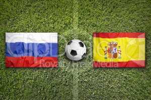 Russia vs. Spain flags on soccer field