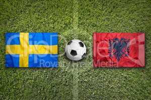 Sweden vs. Albania flags on soccer field