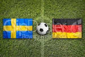 Sweden vs. Germany flags on soccer field
