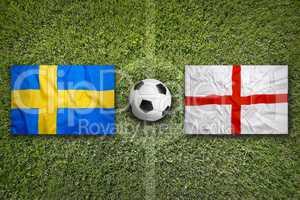 Sweden vs. England flags on soccer field