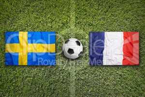 Sweden vs. France flags on soccer field