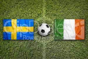 Sweden vs. Ireland flags on soccer field