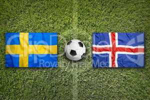 Sweden vs. Iceland flags on soccer field