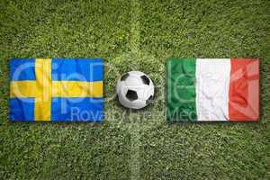 Sweden vs. Italy flags on soccer field