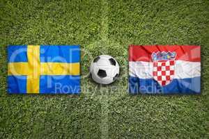 Sweden vs. Croatia flags on soccer field