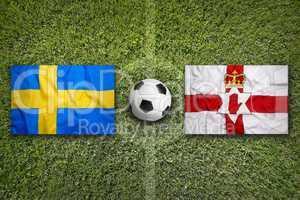Sweden vs. Northern Ireland flags on soccer field