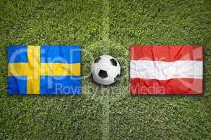 Sweden vs. Austria flags on soccer field