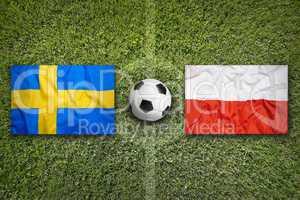 Sweden vs. Poland flags on soccer field