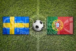 Sweden vs. Portugal flags on soccer field