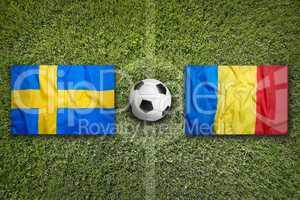Sweden vs. Romania flags on soccer field