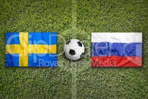 Sweden vs. Russia flags on soccer field