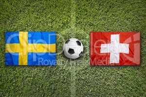 Sweden vs. Switzerland flags on soccer field