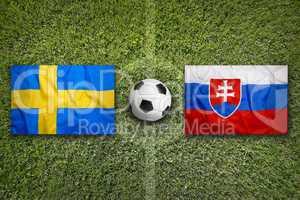 Sweden vs. Slovakia flags on soccer field