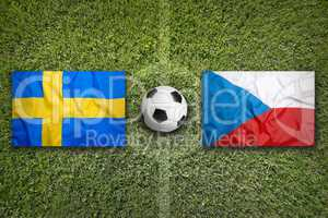 Sweden vs. Czech Republic flags on soccer field