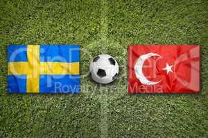 Sweden vs. Turkey flags on soccer field