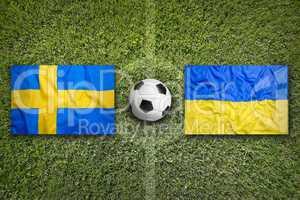 Sweden vs. Ukraine flags on soccer field