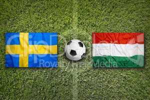 Sweden vs. Hungary flags on soccer field