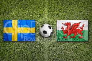Sweden vs. Wales flags on soccer field