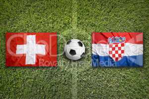 Switzerland vs. Croatia flags on soccer field