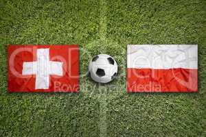 Switzerland vs. Poland flags on soccer field