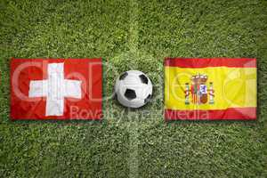 Switzerland vs. Spain flags on soccer field