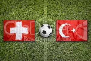 Switzerland vs. Turkey flags on soccer field