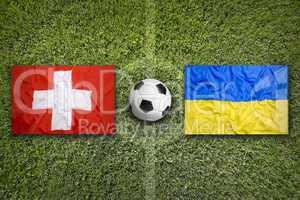 Switzerland vs. Ukraine flags on soccer field