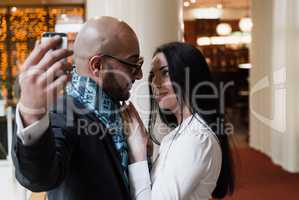 Arab businessman and girl making selfie