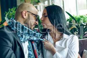 Arab man hugs and kisses a beautiful girl