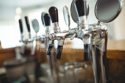 Row of beer taps at cafe