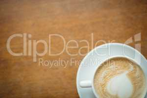 Overhead view of fresh coffee served on table