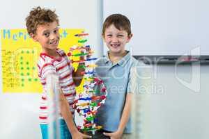Boys holding DNA model
