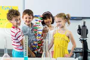 Portrait of children with scientific equipment