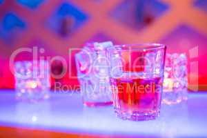 Glass of whiskey at nightclub