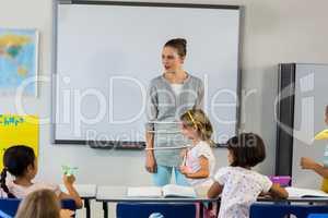 Children tied up female teacher in classroom
