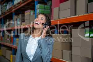 Business woman calling with her headset