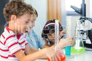 Schoolchildren with scientific equipment