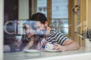 Happy couple bonding at cafe