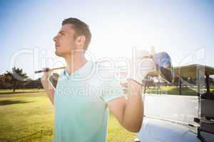 Smart man carrying golf club