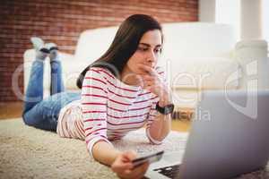 Beautiful woman using debit card for online shopping