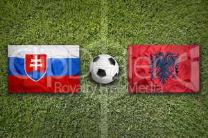Slovakia vs. Albania flags on soccer field