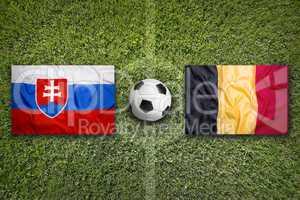 Slovakia vs. Belgium flags on soccer field