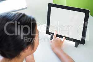 High angle view of girl using digital tablet
