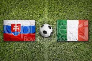 Slovakia vs. Italy flags on soccer field