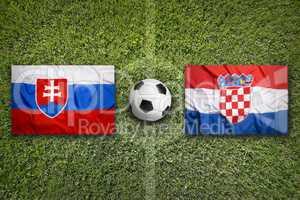 Slovakia vs. Croatia flags on soccer field